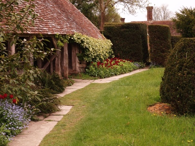 The Hovel provides a pleasant place to sit at the end of the topiary lawn