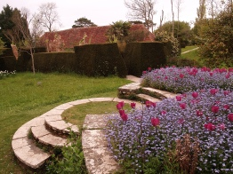 Ebullient planting in the circular steps replaces the original lawn circles creating a softer less formal feel